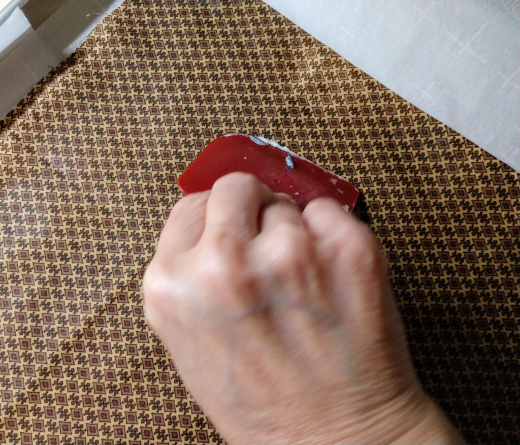 Scrape from the center outward to evenly distribution the wax-Kreateedoo.com